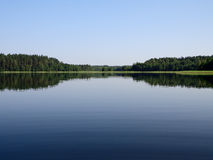 Calm lake. Calm on the lake in summer morning Stock Image