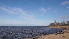 Calm lake on sunny day in spring stock video footage
