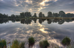 Calm lake at sunrise Stock Photography