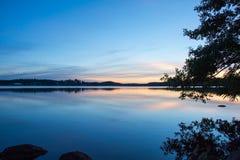 Calm lake before sunrise Stock Image