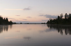 Calm lake sunset. Calm lake photographed at sunset Stock Images