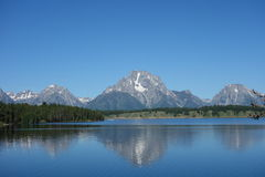 A calm lake with the tetons in the background. Royalty Free Stock Photography