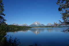 A calm lake with the tetons in the background. Royalty Free Stock Photos