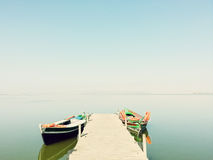 Calm lake with two fishing boats Royalty Free Stock Image