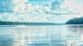Calm Lake Under Cloudy Sky Royalty Free Stock Images