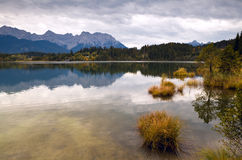 Calm landscape with wild lake and mountains Royalty Free Stock Photos