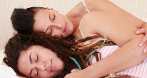 Calm lesbian couple sleeping together in the bed stock video footage
