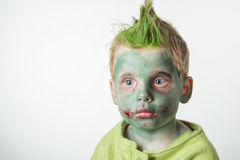 Calm little boy dressed as a zombie Royalty Free Stock Image