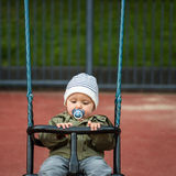 Calm little boy sitting in a swing royalty free stock photography