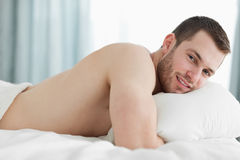 Calm man lying on his belly Royalty Free Stock Images