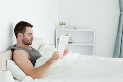 Calm man reading a newspaper Royalty Free Stock Image