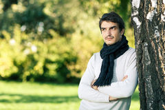 Calm man in scarf looking to side outdoors Royalty Free Stock Photos