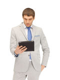 Calm man with tablet pc computer Royalty Free Stock Image