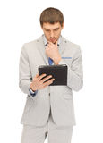 Calm man with tablet pc computer. Picture of calm man with tablet pc computer Stock Photography