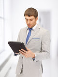 Calm man with tablet pc computer Stock Image