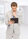 Calm man with tablet pc computer Stock Photo