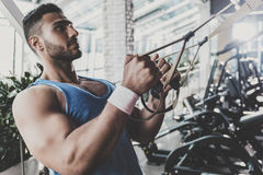Calm man working out in keep-fit studio Royalty Free Stock Image