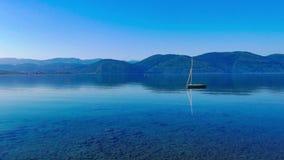 Calm Mediterranean Waters 01. An idyllic view of Akyaka coastline Gulf of Gokova, Mugla, Turkey from the beach, on a quiet spring morning. The water is so calm stock video footage
