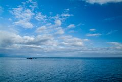 Calm morning sea landscape with cloudy sky and rocks. wide angle. Calm morning sea landscape with cloudy sky. wide angle. Horizontal frame Royalty Free Stock Photography