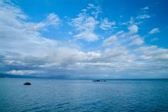 Calm morning sea landscape with cloudy sky and rocks. wide angle. Calm morning sea landscape with cloudy sky. wide angle. Horizontal frame Stock Images