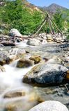 The calm of a mountain creek. A mountain creek in the California foothills. a man made wooden structure in the background Stock Images