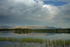 Calm mountain lake and grass near the shore. Yakutia, Omulewska the Midlands Stock Photos