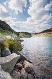 Calm Mountain Lake and Stones Stock Photo