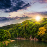 Calm mountain river on a cloudy summer sunset Royalty Free Stock Images