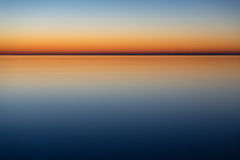 Calm and mystical sea by night Stock Photos