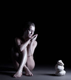 Calm naked woman posing as revived stone statue Royalty Free Stock Image
