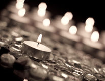 Calm Night. Single Candle Focus on Glass Beads in Aged Film Effect Royalty Free Stock Photo