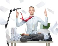Calm no matter what. Calm business woman despite huge disorder on table and flying papers Stock Photos