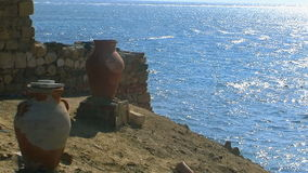 Calm ocean with blue sky and amphora . stock footage