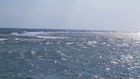Calm ocean with blue sky . Calm ocean with blue sky and horizon stock footage
