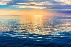 Calm ocean at sunset. Dramatic sky stock image