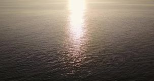 Calm ocean with sunset reflection stock video