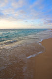 Calm ocean on tropical sunrise Royalty Free Stock Image