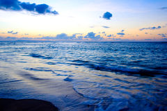 Calm ocean on tropical sunrise Stock Image