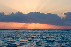 Calm ocean on tropical sunrise Stock Photo