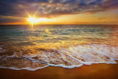 Calm ocean during tropical sunrise Stock Photos