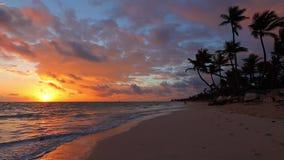 Calm ocean waves on sunrise and tropical island beach