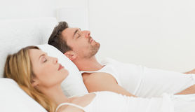 Calm pairs sleeping together. At home Royalty Free Stock Image