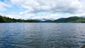 Calm peaceful lake Windermere in Cumbria, England. Cloudy weather. Daytime. Video footage stock video