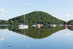 Calm peaceful relaxed morning on a still day at a beautiful lake with cloud reflections Stock Photography