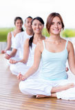 Calm people doing yoga Royalty Free Stock Image