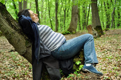 Calm pregnant woman relaxing in the forest Royalty Free Stock Images