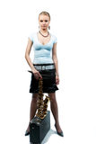 Calm pretty blonde girl with saxophone Stock Photo