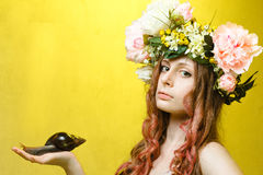 Calm pretty girl with snail and flower crown Royalty Free Stock Photography