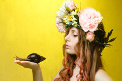 Calm pretty girl with snail and flower crown Stock Photo