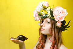 Calm pretty girl with snail and flower crown Stock Image